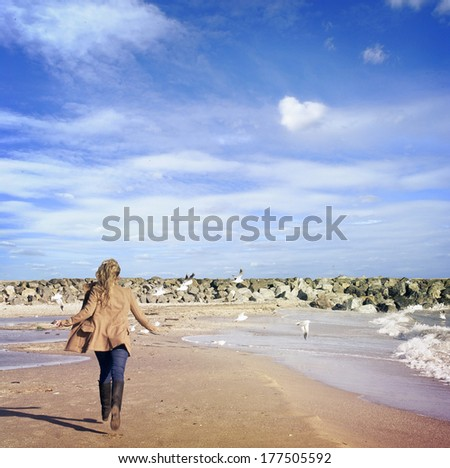 woman having fun on the beach - stock photo