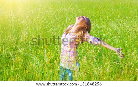 Woman having fun outdoor, enjoying fresh air and spring green grass, freedom and happiness concept - stock photo