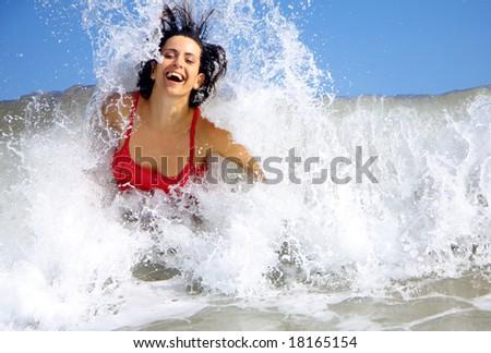 Woman having fun with waves - stock photo