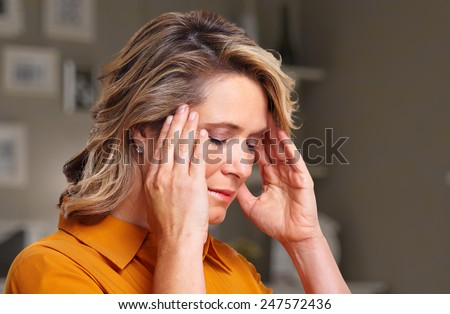 Woman having headache migraine. Stress and depression. - stock photo