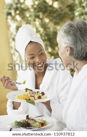 Woman having healthy food with friend - stock photo