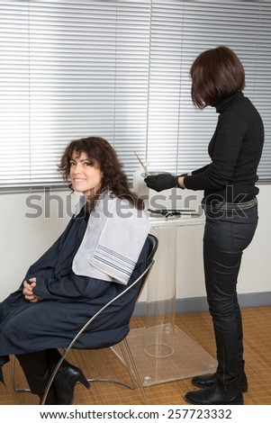 Woman having her hair dyed by beautician at parlor - stock photo