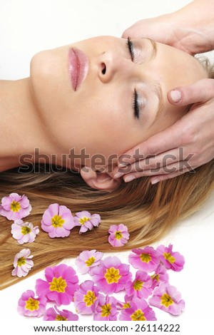 woman having massage in spa - stock photo