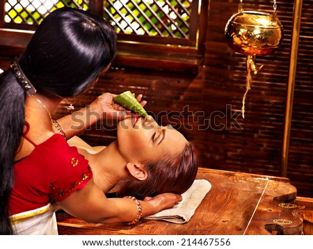Woman having nose ayurveda spa treatment. - stock photo