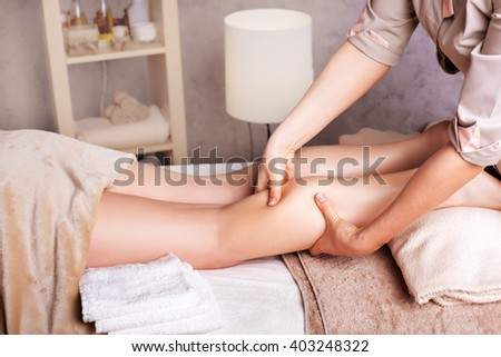 Woman having  rejuvenating foot massage for athletes, in Spa Salon  - stock photo