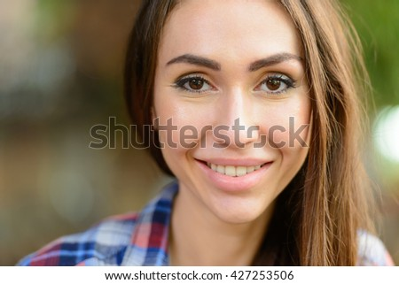 Woman head shot outdoors