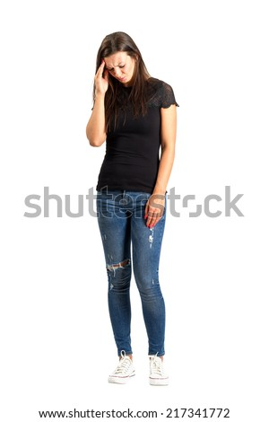 Woman headache concept. Full body length isolated over white. - stock photo