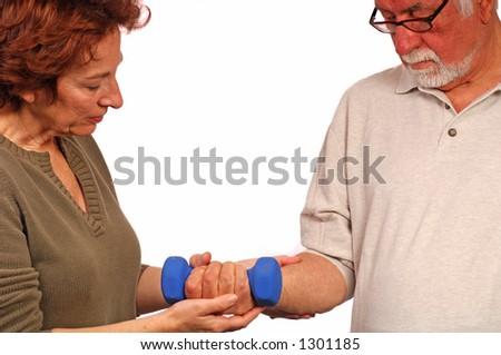 Woman helps man regain strength - stock photo