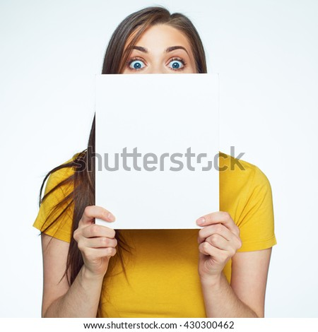 Woman hides face behind white sign board. Isolated white background.