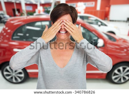 Woman hiding her face with hands. Auto dealership and rental concept background. - stock photo