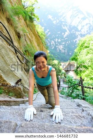 woman hiker climbing mountain hua - stock photo