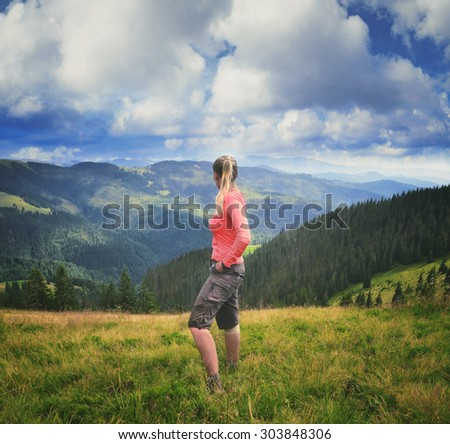 Woman hiker on a top  in Carpathian Mountains