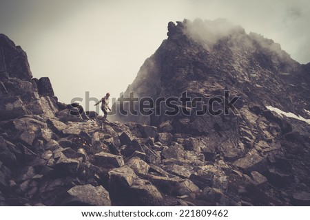 Woman hiker walking in a mountains