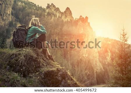 Woman hiking around mountains at spreeng time. - stock photo