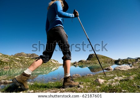 woman hiking in the mountain - stock photo