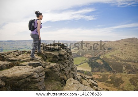 woman hiking on mountains at Kinder Plateau, Peak District, England - stock photo