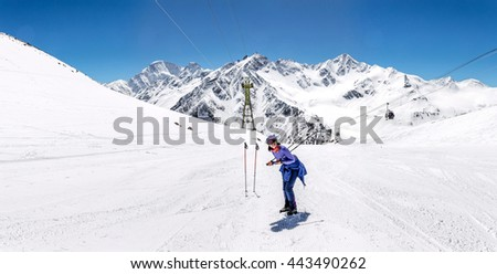 Woman hiking on sunny winter day in mountain landscape.  - stock photo