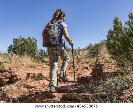 Woman hiking outdoors on trail - stock photo