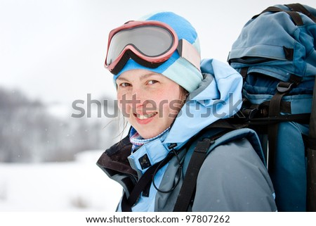 Woman hiking portrait in winter mountains