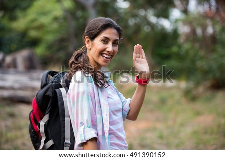 Woman hiking through a forest in the countryside
