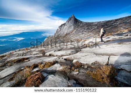 Woman hinking down Kinabalu mountain in Kinabalu national park. Kota kinabalu - Malasia. - stock photo