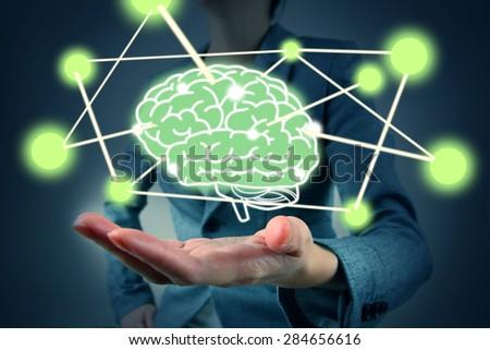woman hold brain symbol on hand - stock photo
