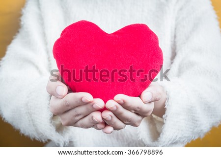 Woman hold Love symbol red heart - people, relationship and love concept