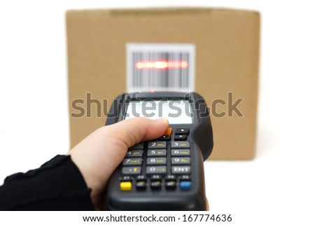 woman hold scanner and scans barcode with laser - stock photo
