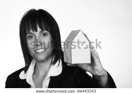 woman hold up a small model house wrapped up - stock photo