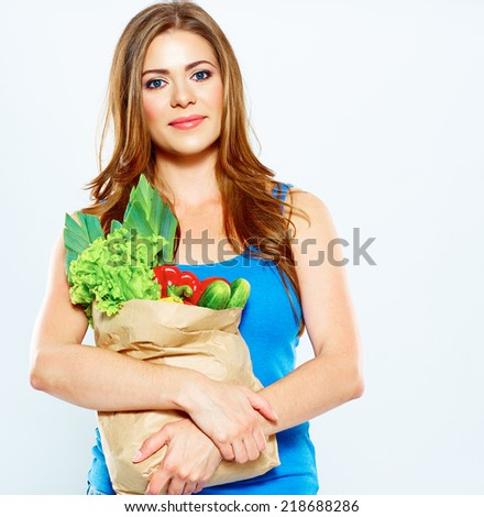 woman hold vegetables in grocery bag . food shopping . white background .