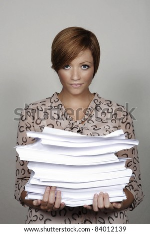 woman holdind a big pile of paper work - stock photo