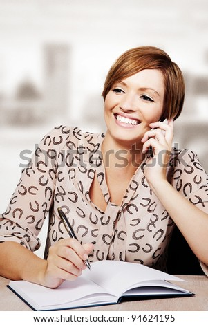 woman holding a big pile of paper work - stock photo