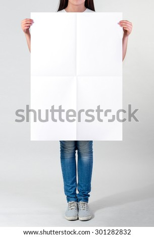 Woman holding a blank A1 poster - stock photo