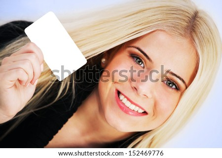 Woman holding a blank gift card - stock photo