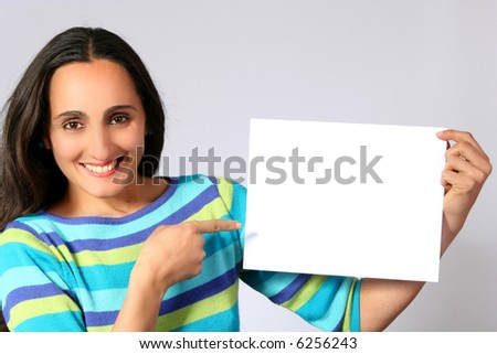 Woman holding a blank paper - stock photo