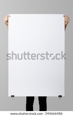 Woman holding a blank poster, 70x100, mockup. - stock photo