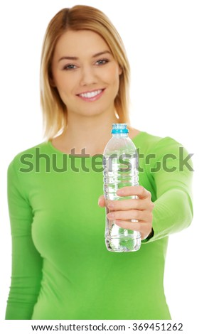 Woman holding a bottle of water. - stock photo