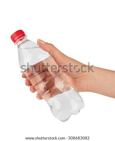 Woman holding a bottle of water isolated on white background