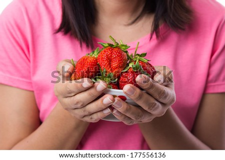 Woman Holding a bowl full of Strawberries - stock photo