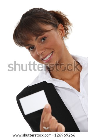 Woman holding a business card - stock photo