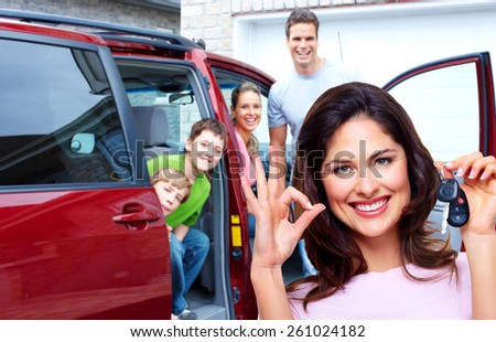 Woman holding a car key. Auto repair service - stock photo