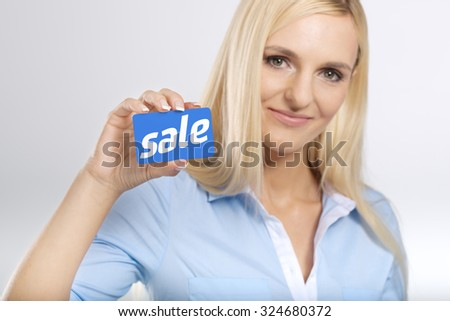 woman holding a card - stock photo