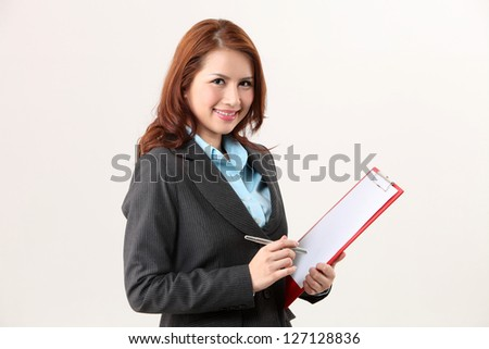 woman holding a clip board looking at camera