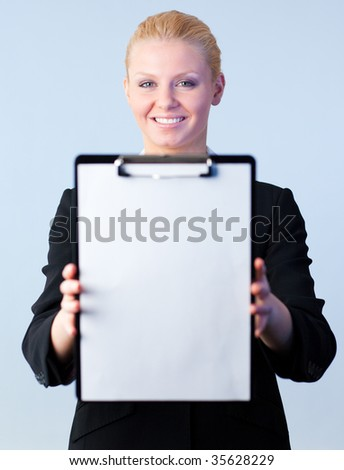 Woman holding a clipboard with the camera focus on the person - stock photo