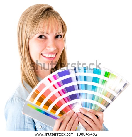 Woman holding a color guide - isolated over a white background