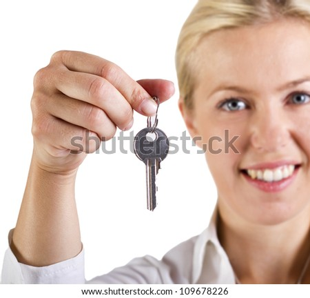 Woman holding a key - stock photo