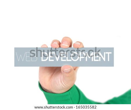 woman holding a label with web development - stock photo