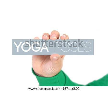 woman holding a label with yoga poses - stock photo