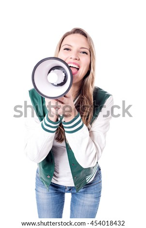 Woman holding a loudhailer, shouting into it with a passion. - stock photo