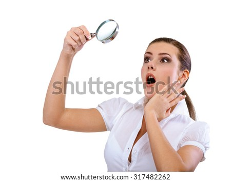 Woman holding a magnifying glass, isolated on white background. - stock photo